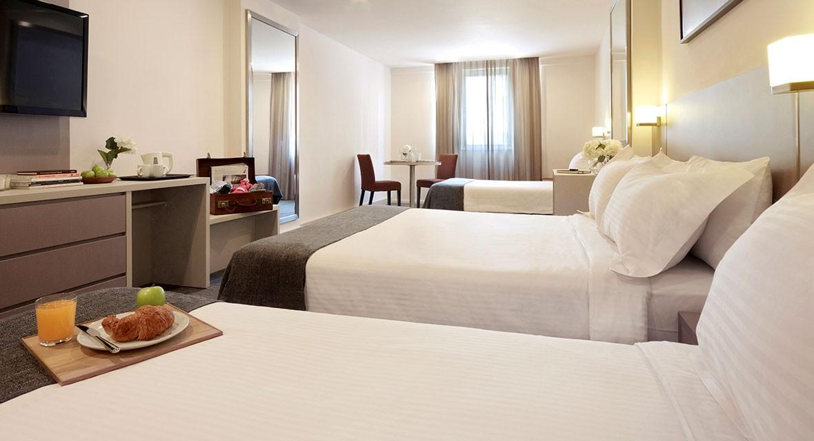 Family room strand hotel singapore for Design strandhotels